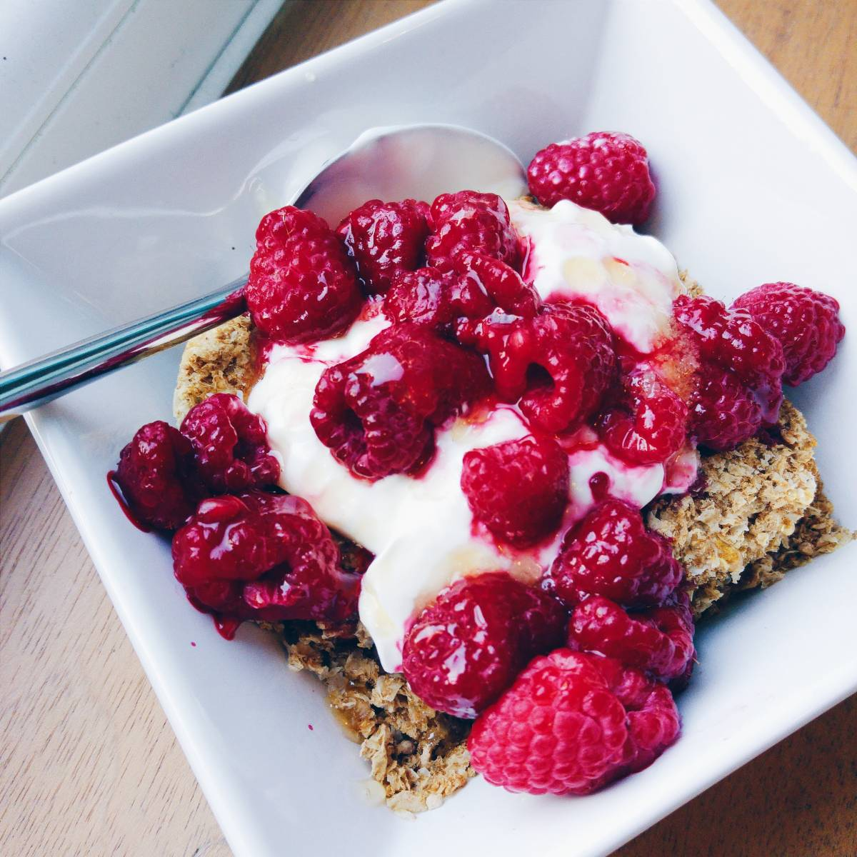 Protein Weetabix with Greek yoghurt, raspberries and honey
