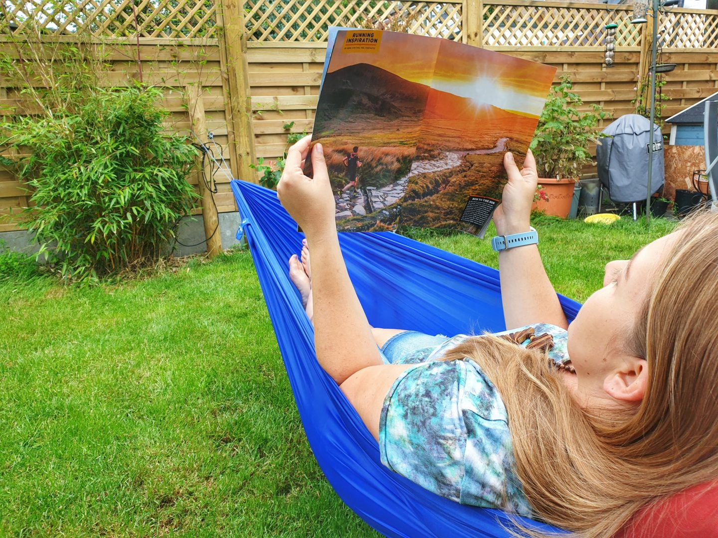 Reading a magazine in a hammock