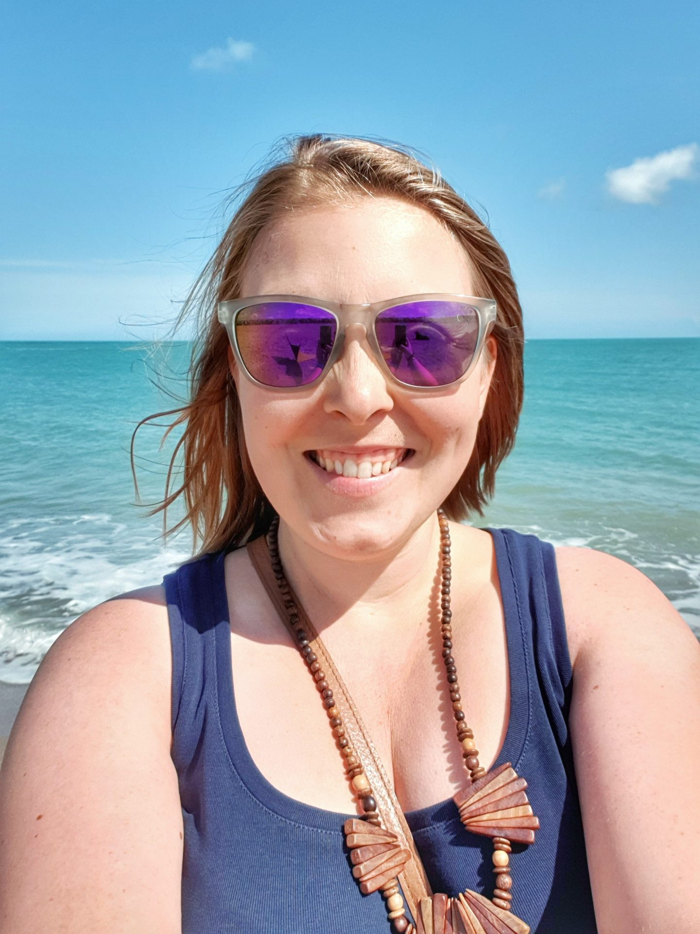 Beki (Miss Wheezy) selfie on the beach in front of the sea