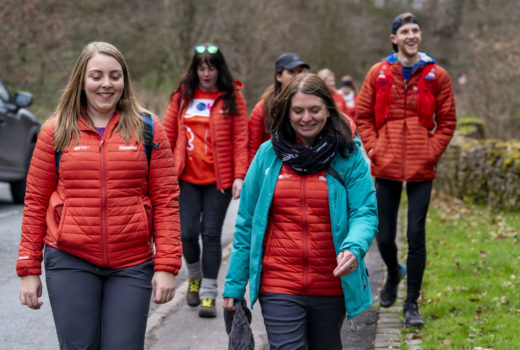 GetOutside Champions in orange jackets walking along the road