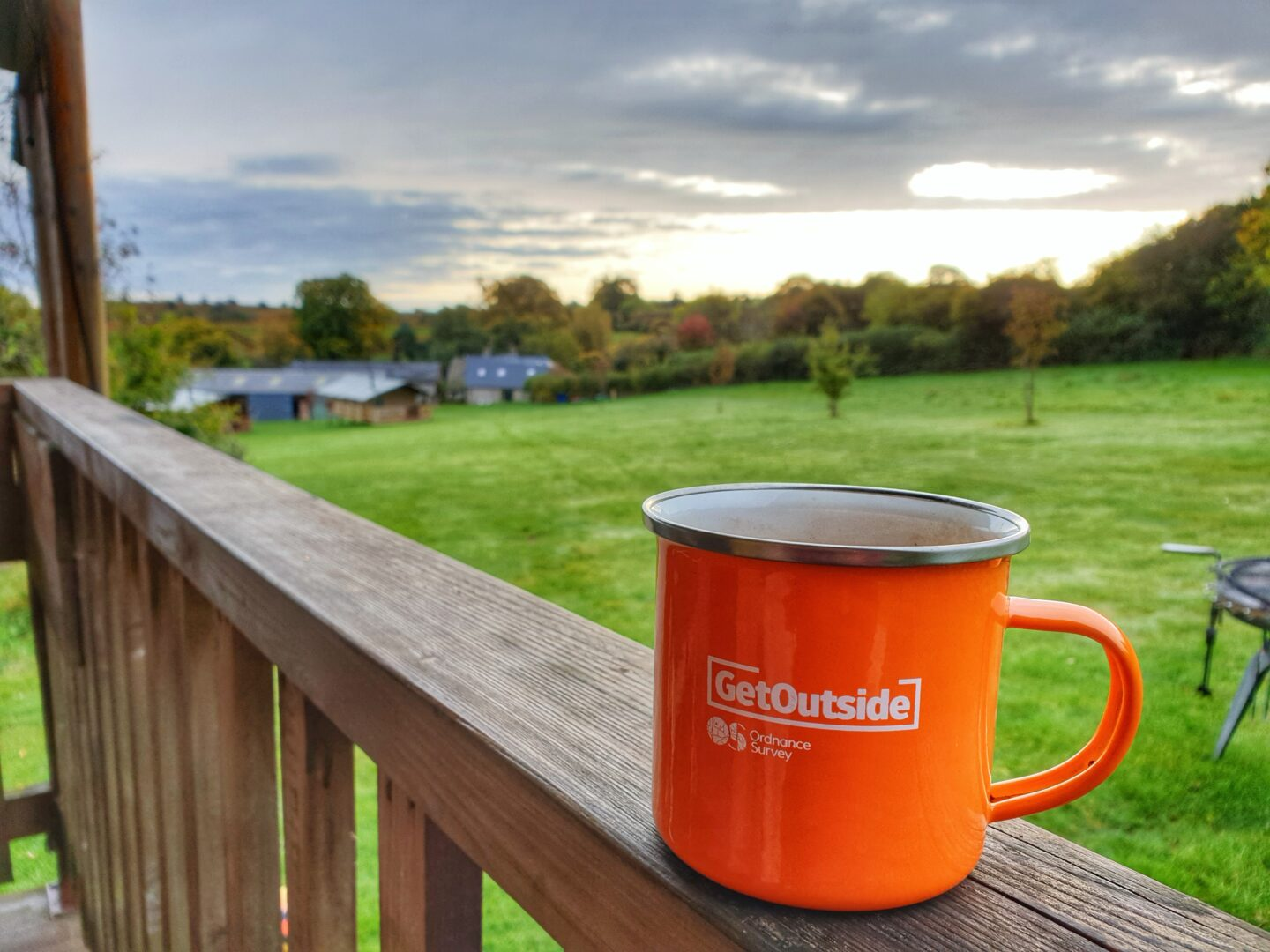 GetOutside orange mug with view of Drovers Rest glamping site