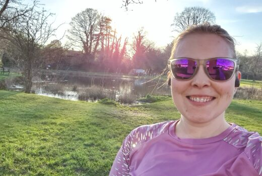 Running selfie in front of pond